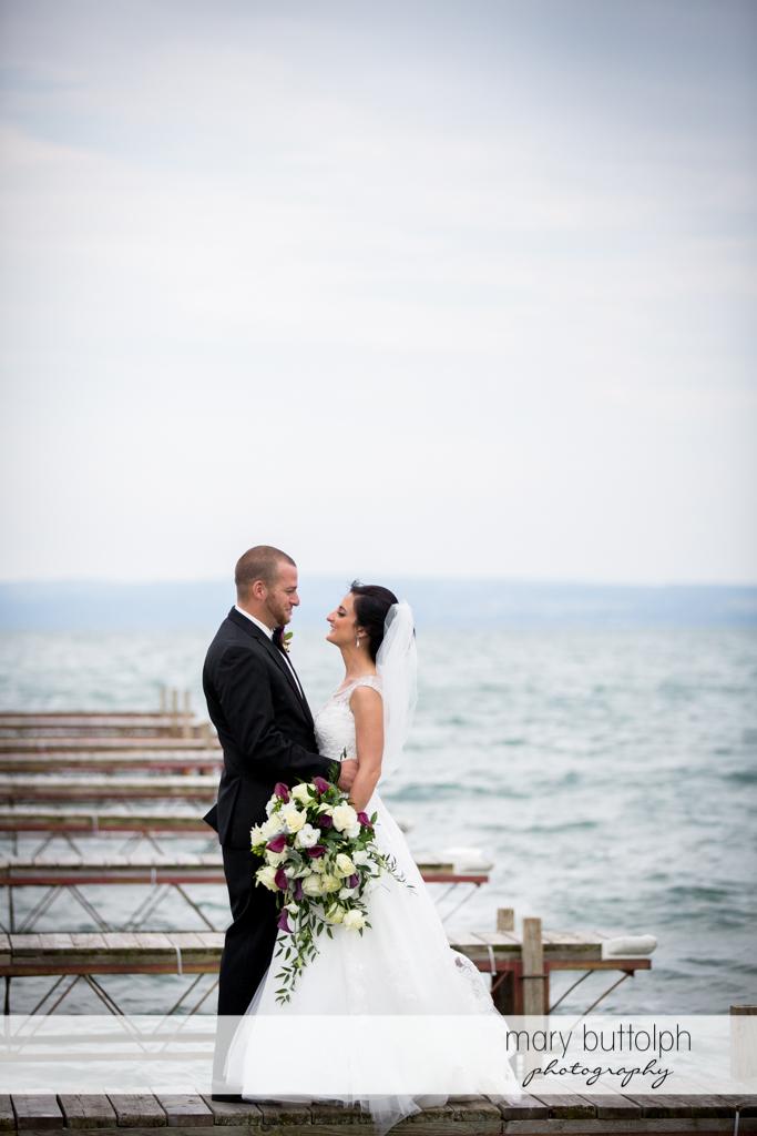 Couple pose in one of the docks at Anyela's Vineyards Wedding
