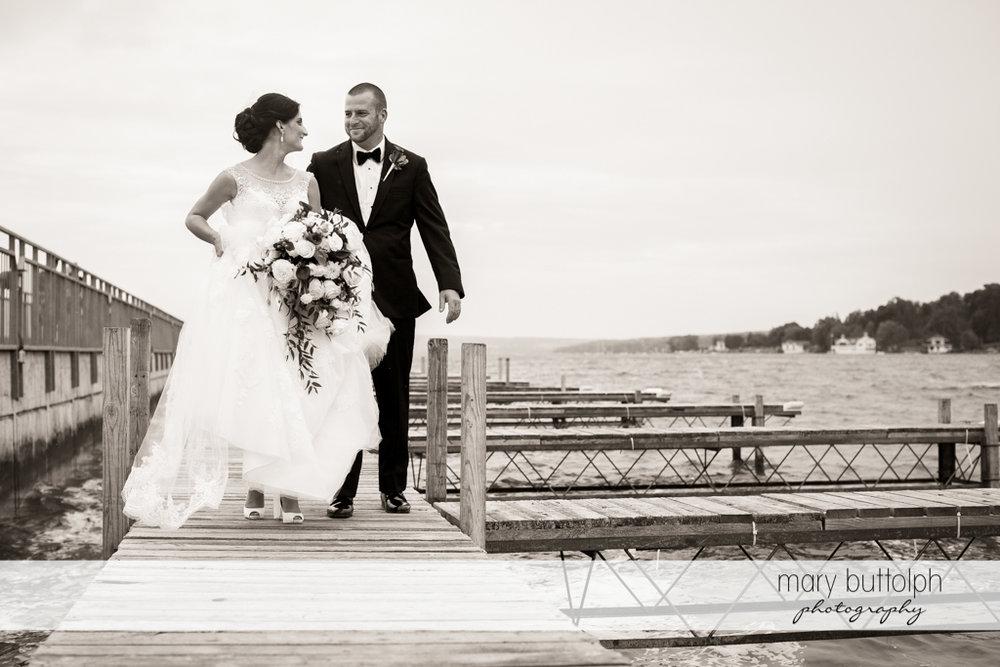 Couple walk along the docks at Anyela's Vineyards Wedding