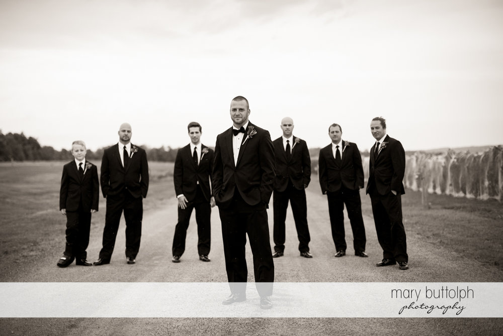 The groom poses with his groomsmen at Anyela's Vineyards Wedding