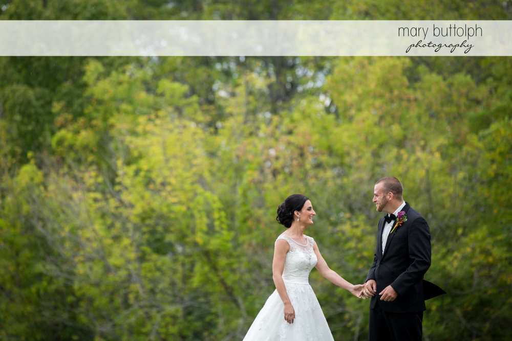 Couple spend a quiet time in the garden at Anyela's Vineyards Wedding