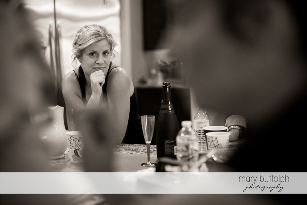 A guest stares at the bride during her makeover session at Anyela's Vineyards Wedding
