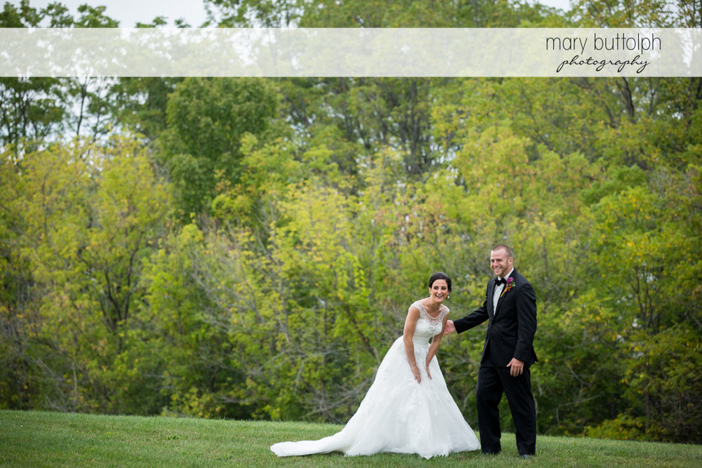 Couple share a laugh in the garden at Anyela's Vineyards Wedding