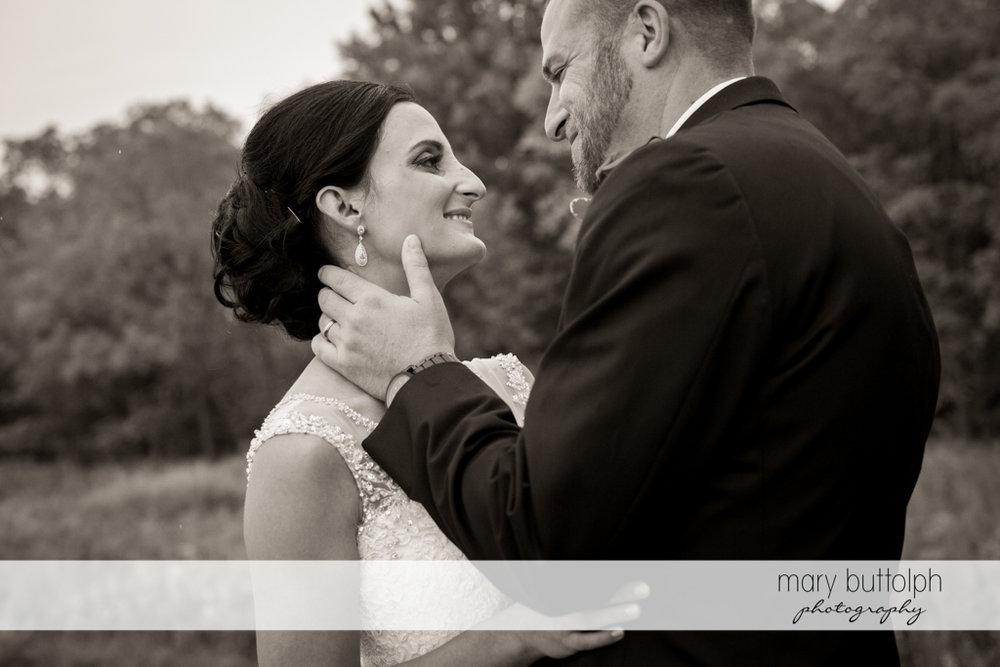 Medium shot of couple in the garden at Anyela's Vineyards Wedding
