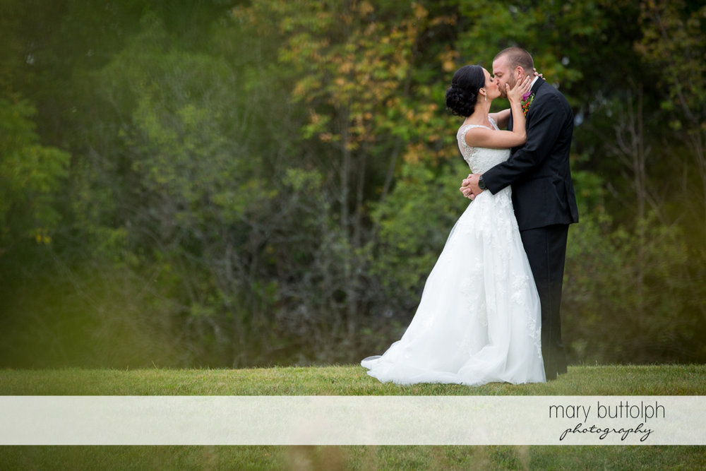 Couple show their love in the garden at Anyela's Vineyards Wedding