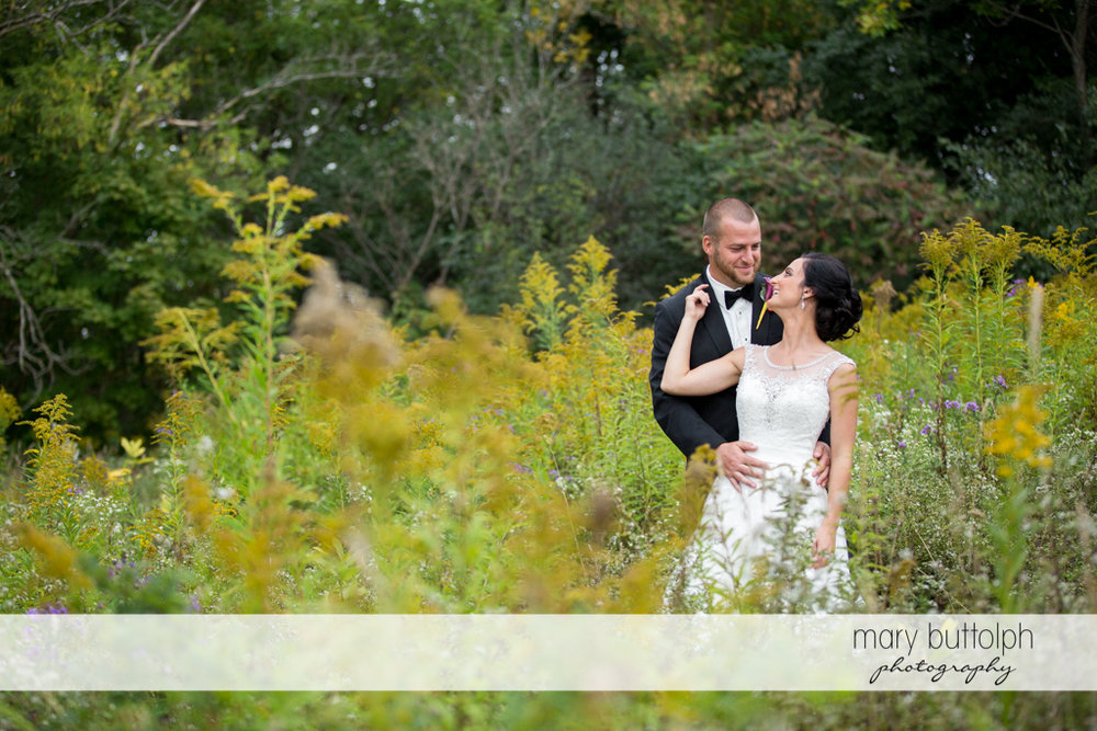 Couple enjoy their time in the garden at Anyela's Vineyards Wedding