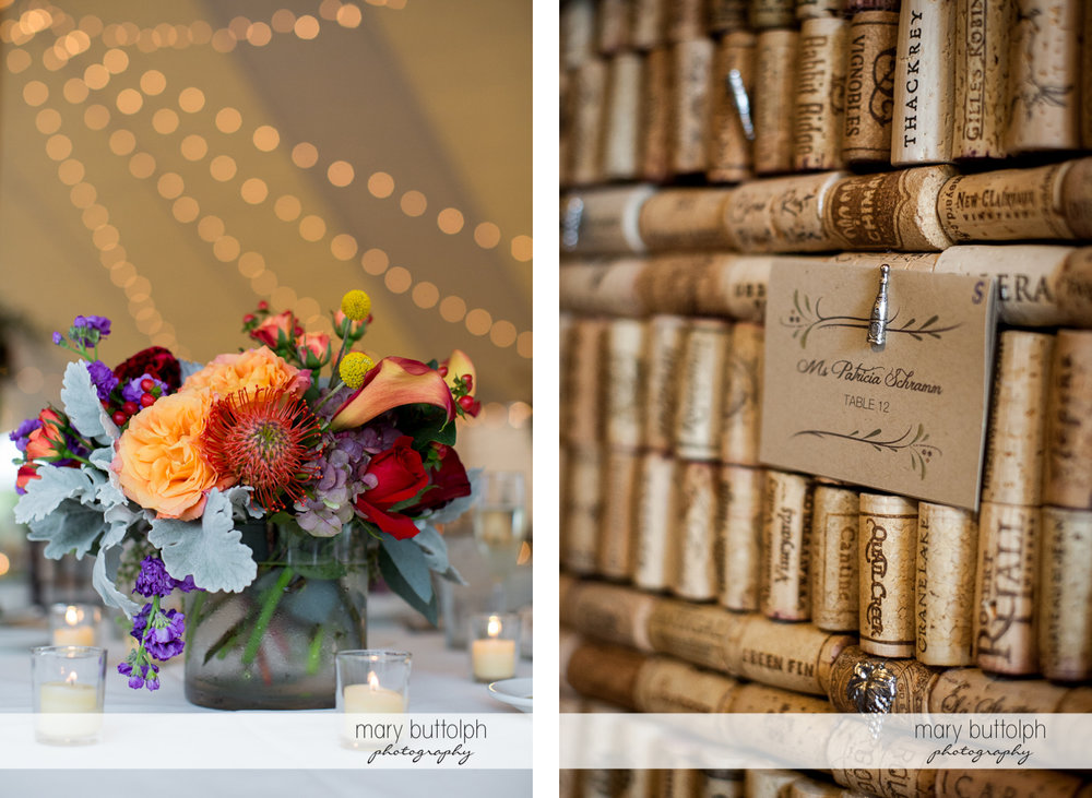 Flowers decorate the table at the wedding reception while a guest's table number sits on top of wine corks at Anyela's Vineyards Wedding