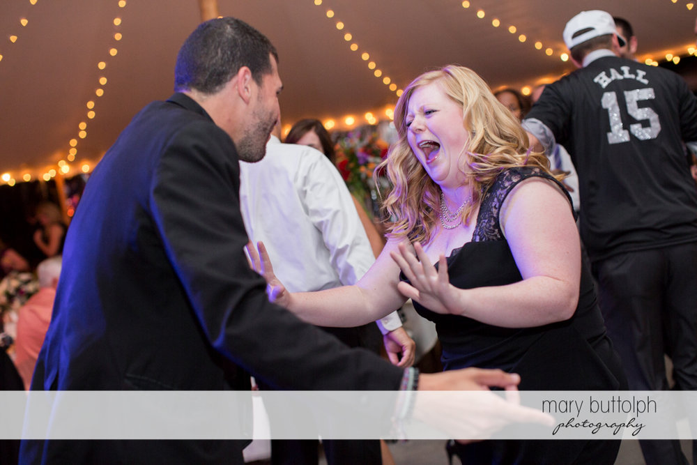 Guests show their moves on the dance floor at Anyela's Vineyards Wedding