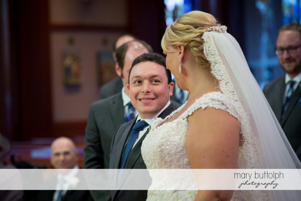 Couple face each other in church at the Lodge at Welch Allyn Wedding