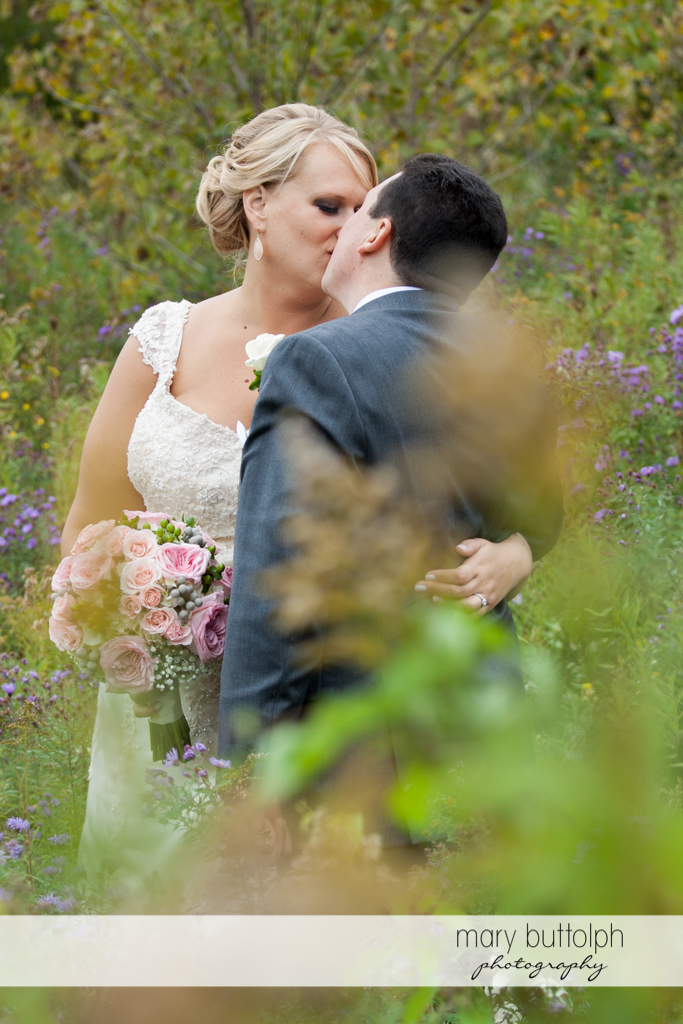 Couple get romantic in the meadow at the Lodge at Welch Allyn Wedding