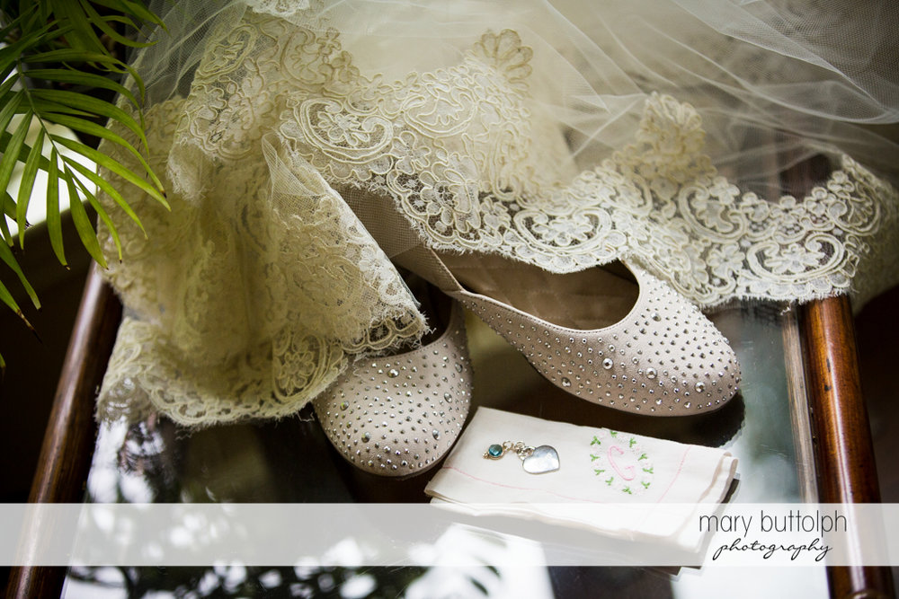 Bride's wedding shoes are partly covered by her wedding dress at the Lodge at Welch Allyn Wedding