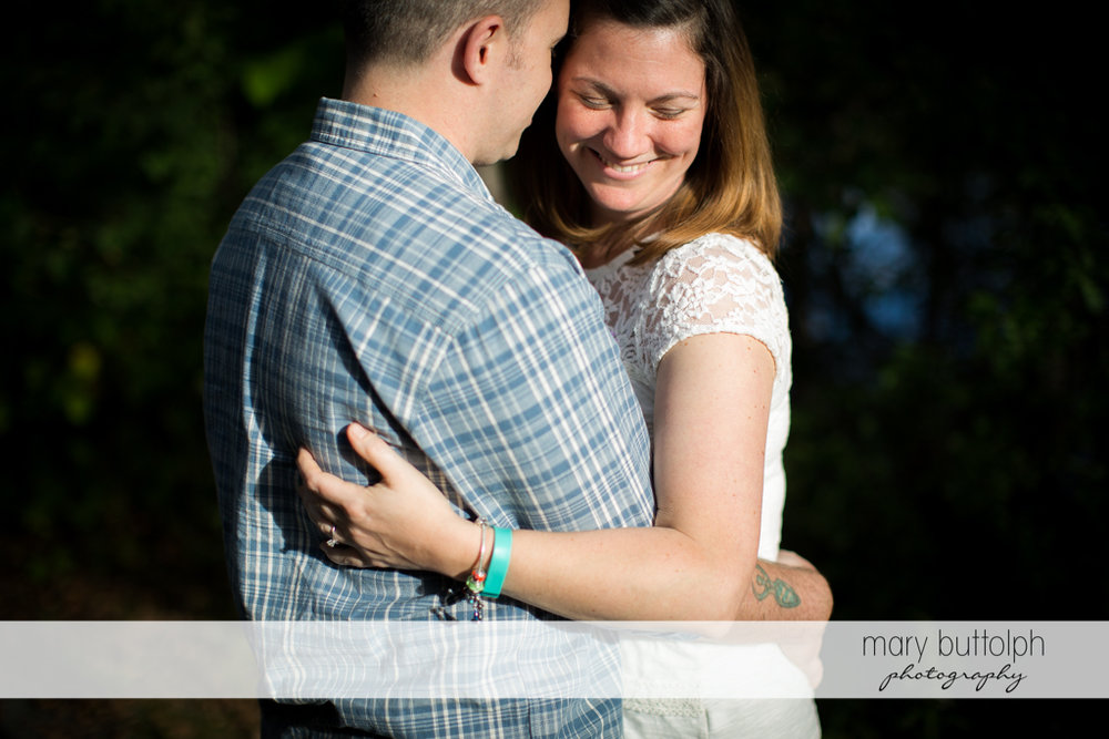 Couple in loving embrace at Skaneateles Engagement