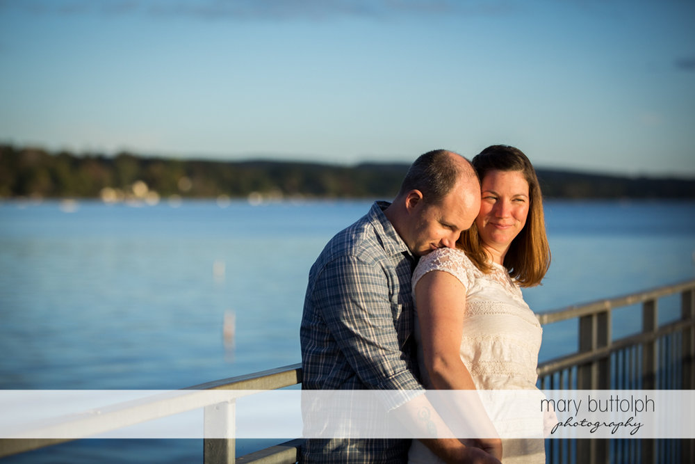 Couple rest by the lake at Skaneateles Engagement