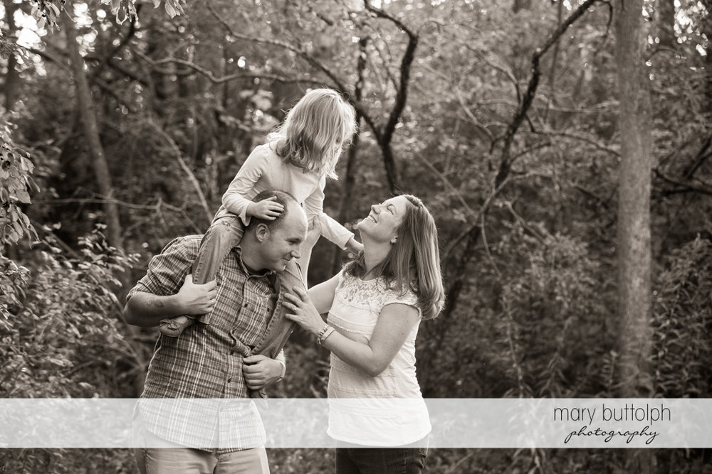 Couple play with their daughter at Skaneateles Engagement