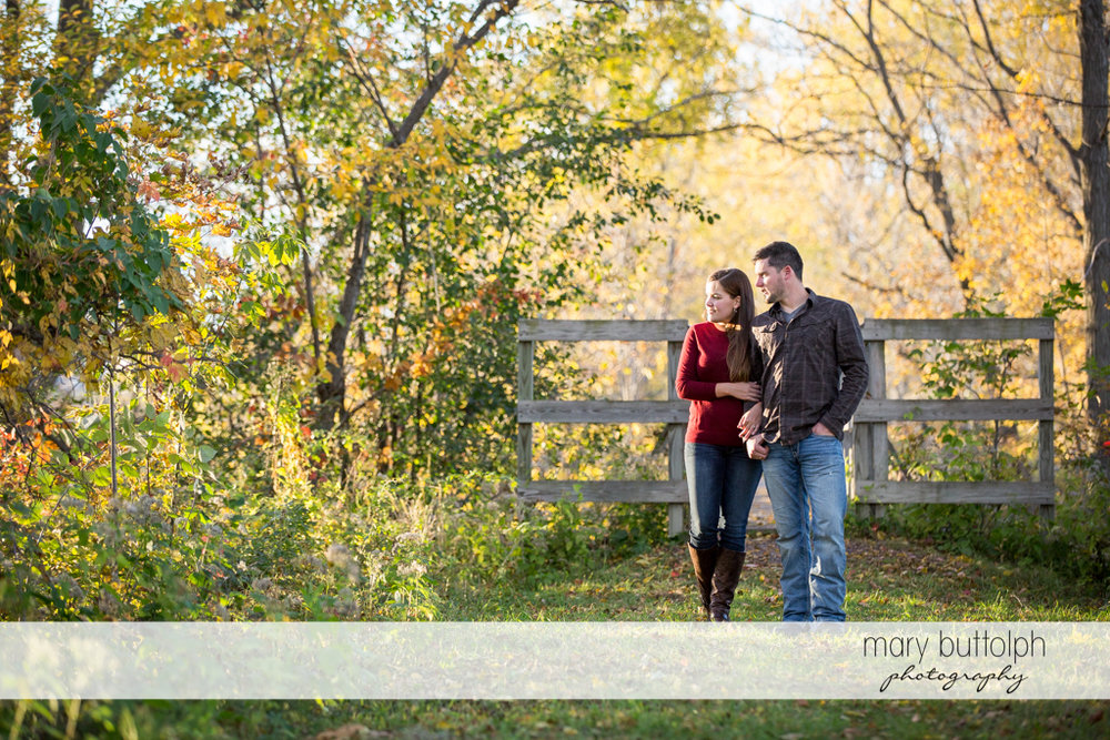 Couple stroll at the farm at Geneva Engagement