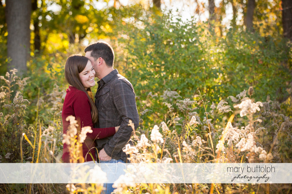 Couple surrounded by flowers at the farm at Geneva Engagement
