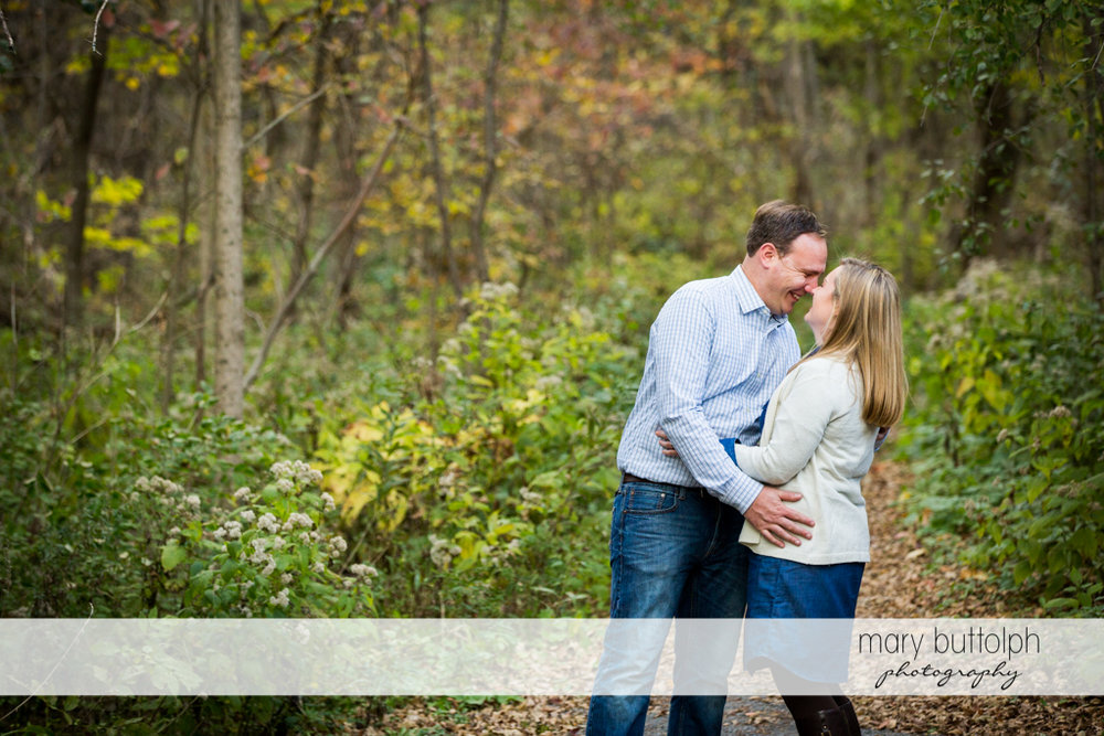 Couple embrace in the park at Erie Canal Engagement