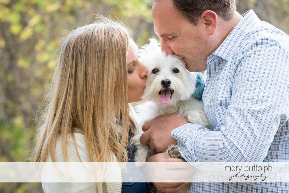 Couple smooch their pet dog at Erie Canal Engagement
