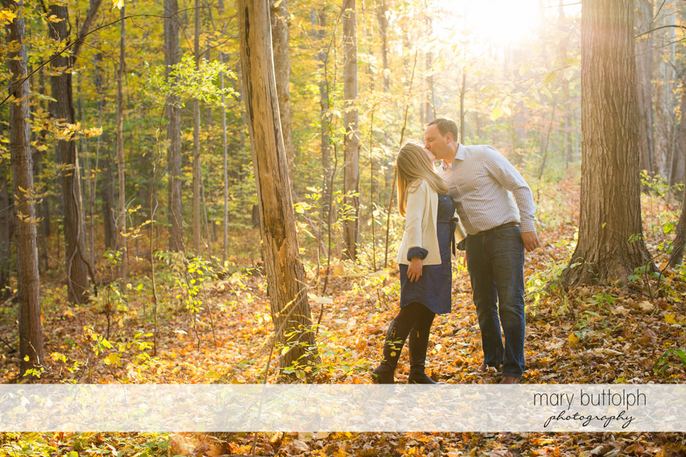 Couple kiss in the park at Erie Canal Engagement