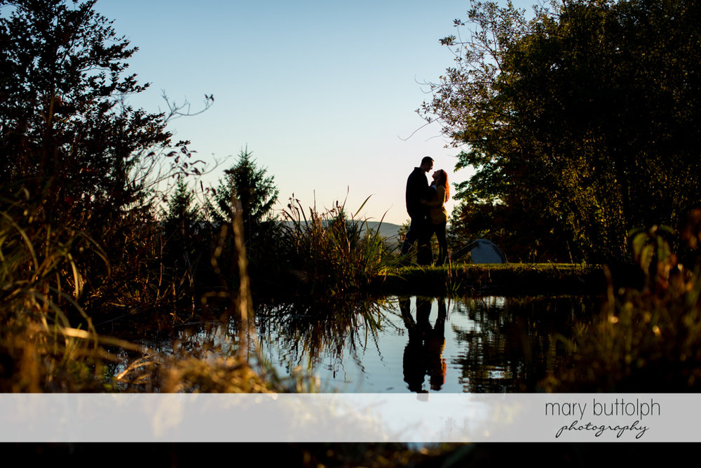 Couple in dramatic shot by the lake at Cazenovia Engagement