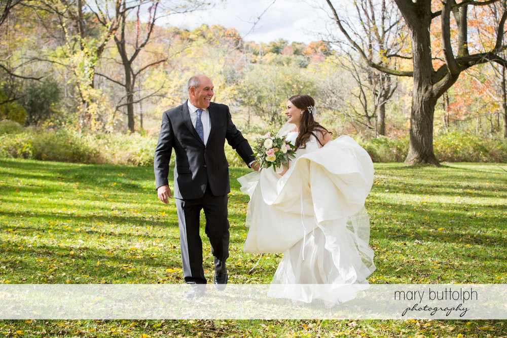Bride and her father take stroll in the garden at the Frog Pond Bed & Breakfast Wedding