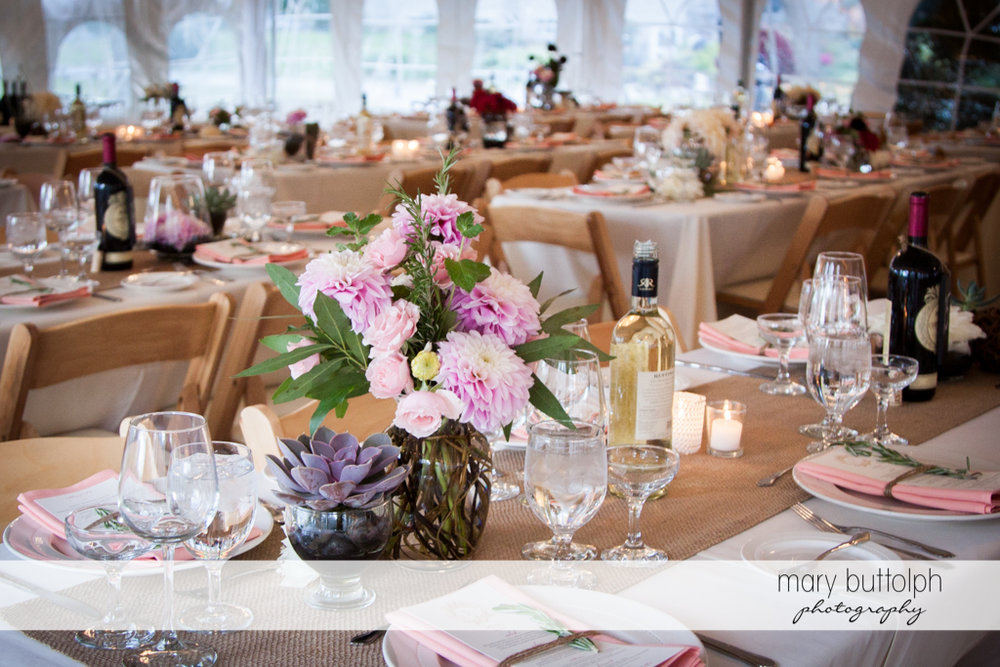 Flowers decorate the tables at the wedding venue at the Frog Pond Bed & Breakfast Wedding