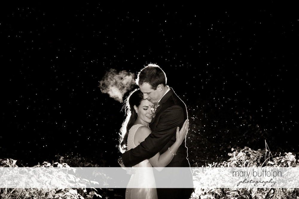 Couple embrace beneath the stars in the garden at the Frog Pond Bed & Breakfast Wedding