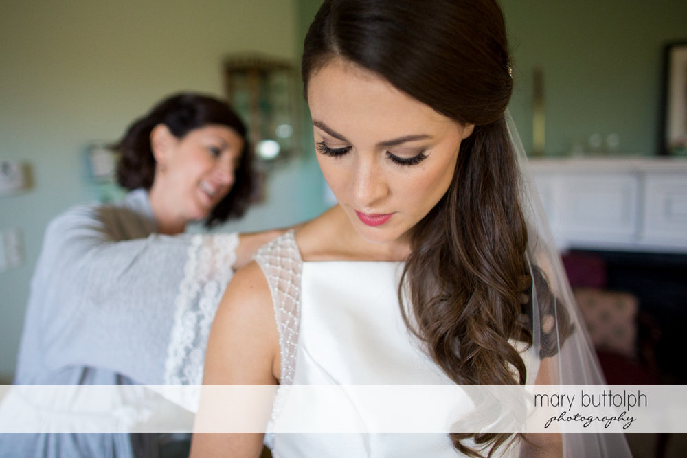 Bride with friend prepare for the big day at Frog Pond Bed & Breakfast Wedding