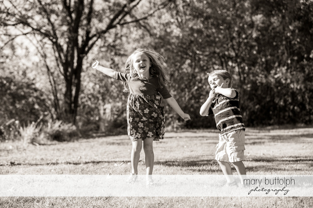 Girl and her brother have fun in the garden at Skaneateles Lake