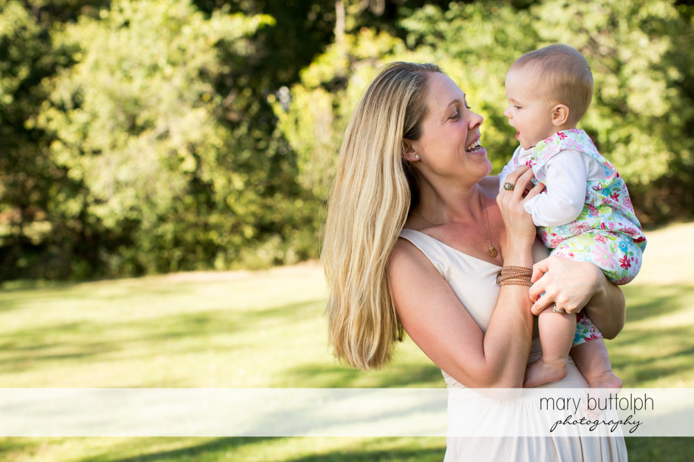 Woman and her baby relax in the garden at Skaneateles Lake