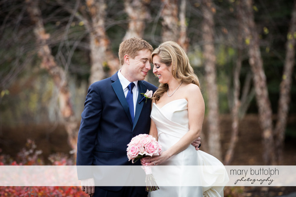Couple get romantic in the woods at the Lodge at Welch Allyn Wedding