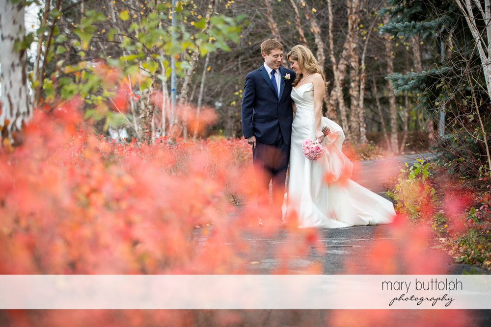Couple pose in the woods at the Lodge at Welch Allyn Wedding