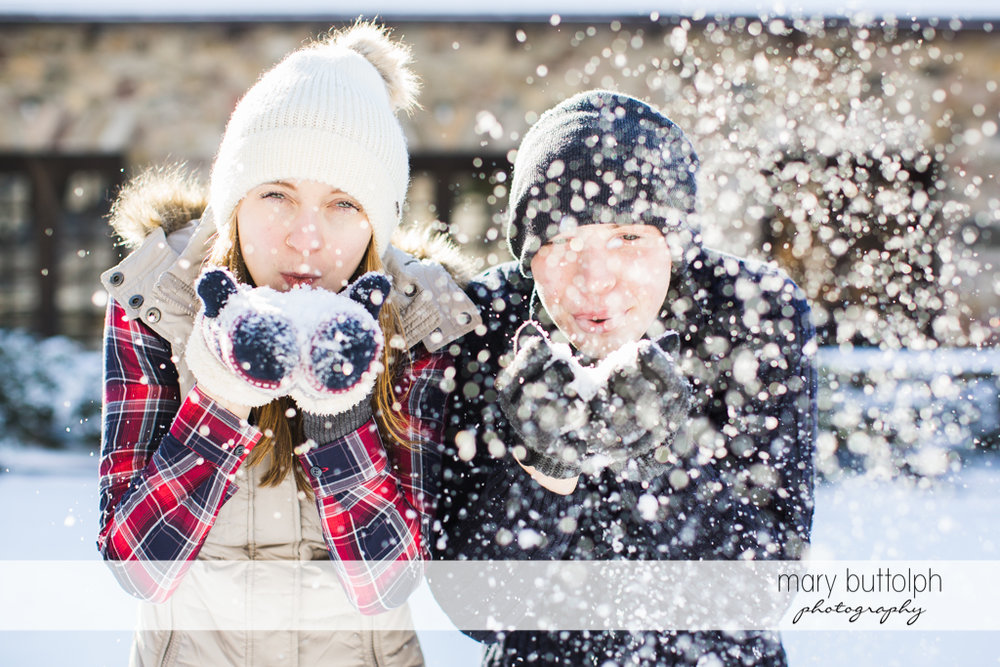 Couple play with snow at Green Lakes Engagement