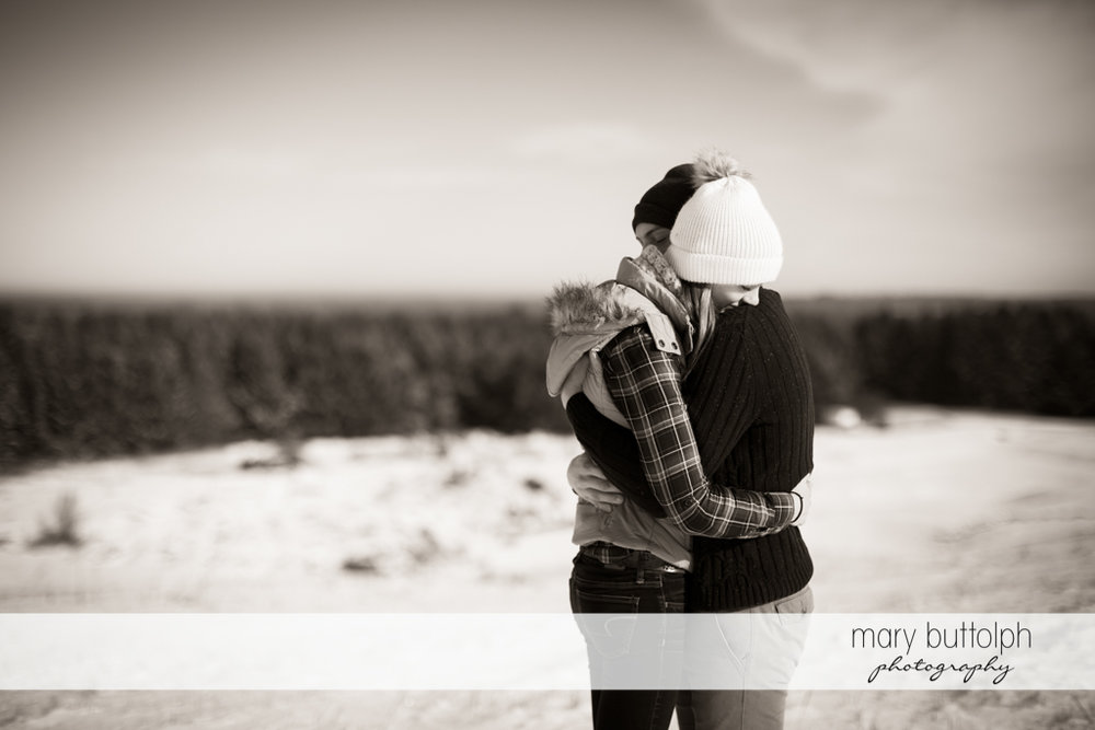 Couple embrace to keep warm at Green Lakes Engagement