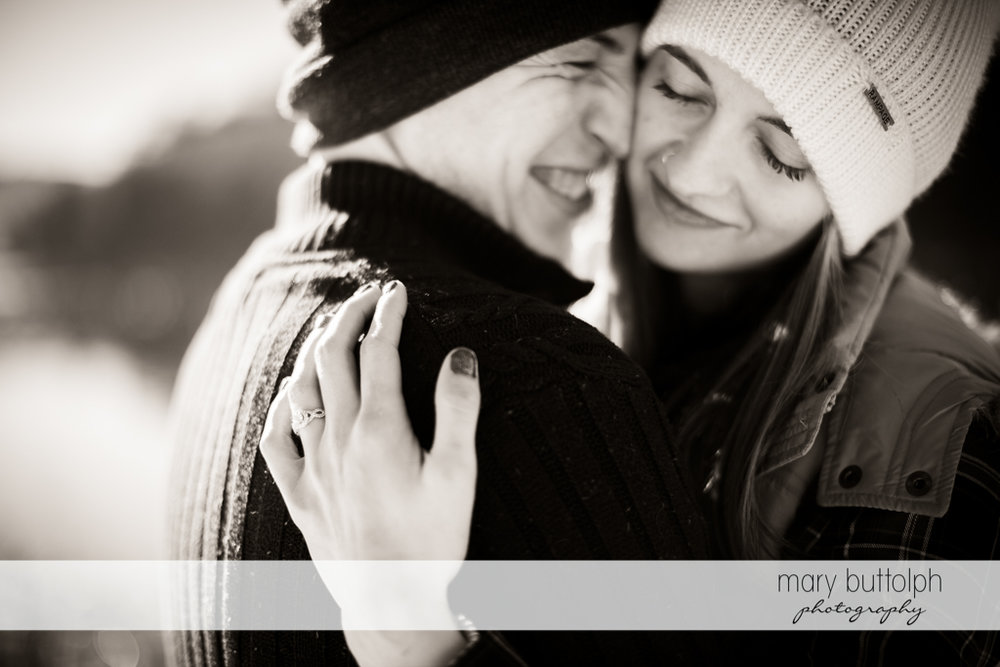 Couple share happy moment by the lake at Green Lakes Engagement