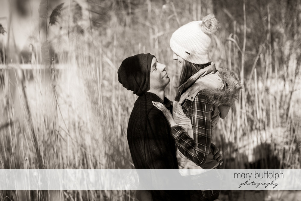 Couple hug tightly in garden at Green Lakes Engagement