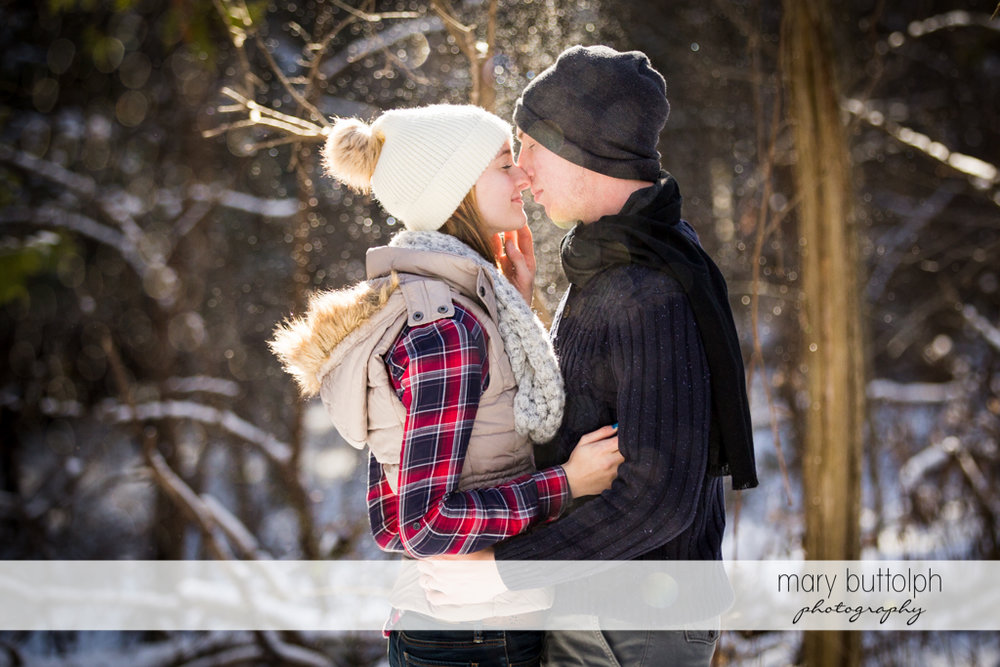Couple share tender moment in the snow at Green Lakes Engagement