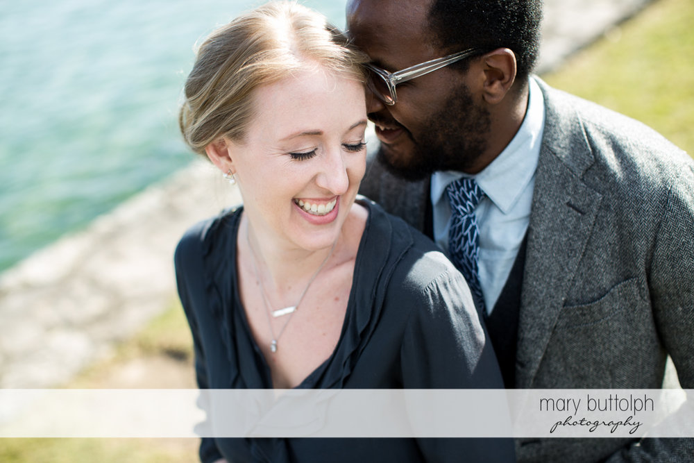 Couple share precious moments by the lake at Skaneateles Engagement