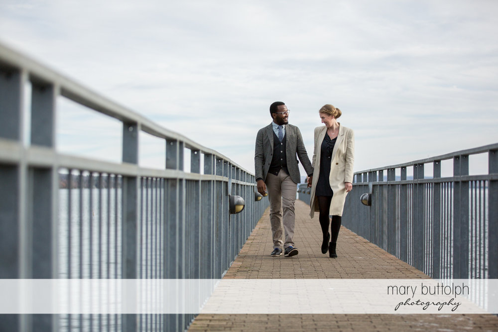 Couple stroll by the lake at Skaneateles Enagagement