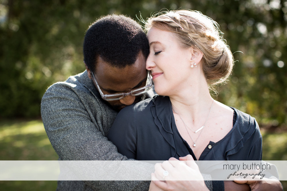 Couple in tight embrace in the park at Skaneateles Engagement