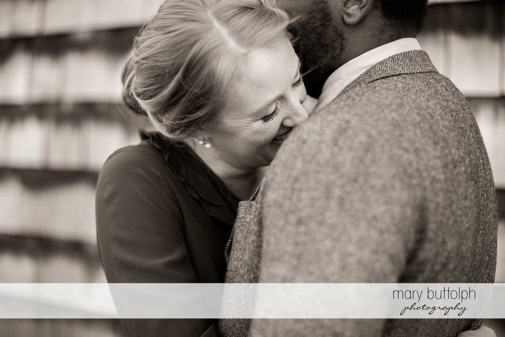Couple hug each other at Skaneateles Engagement