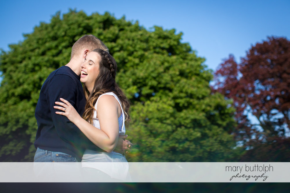 Couple dwarfed by trees at Hobbit Hollow Engagement