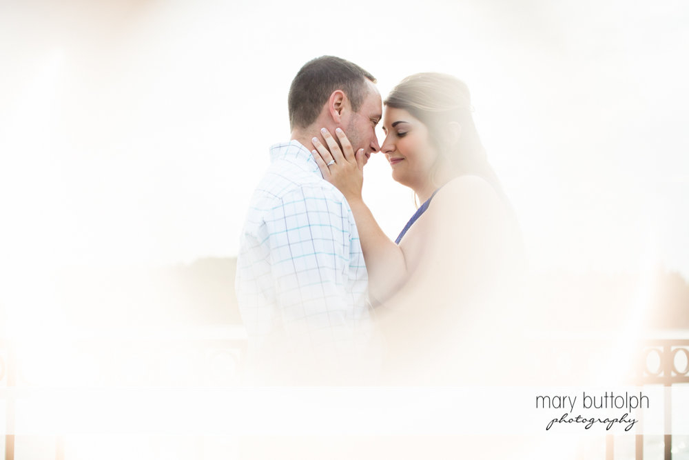 Couple are covered in white light at Emerson Park Engagement