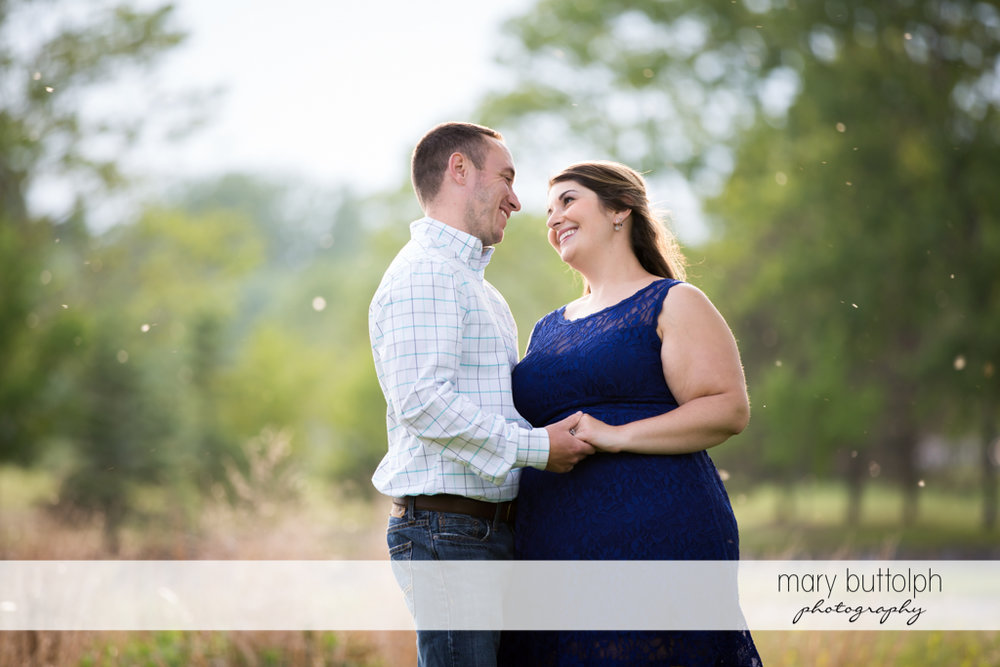 Couple smile at each other at Emerson Park Engagement