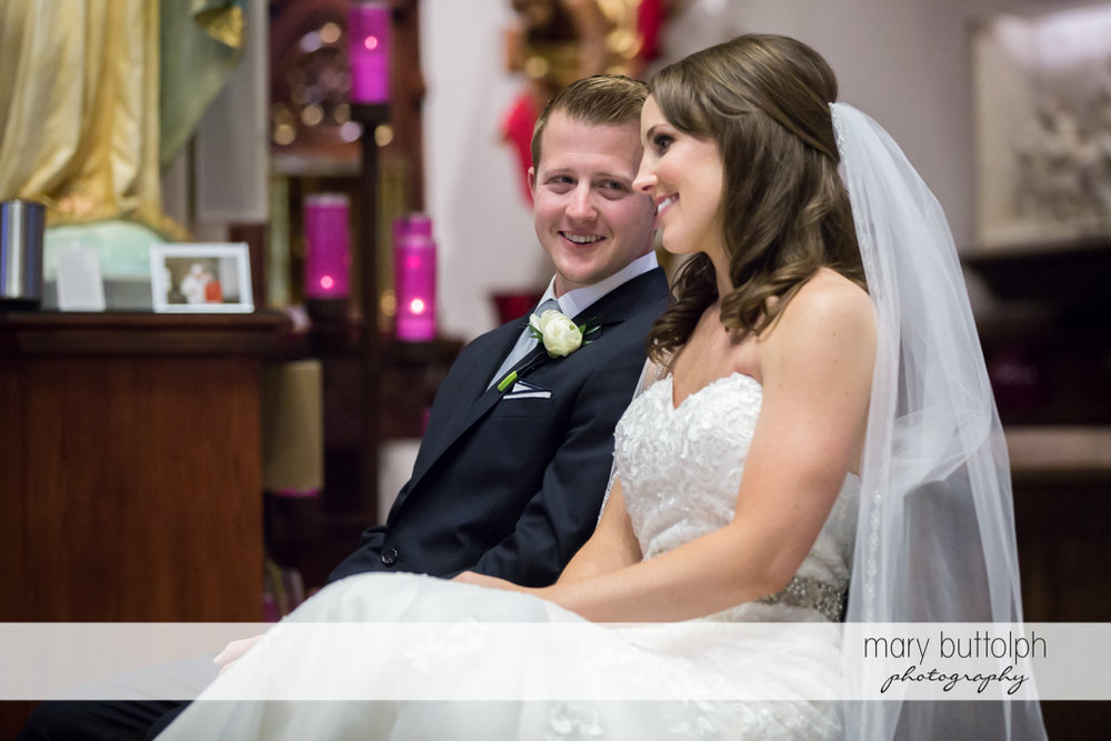 Couple smile during the wedding ceremony at Skaneateles Country Club Wedding