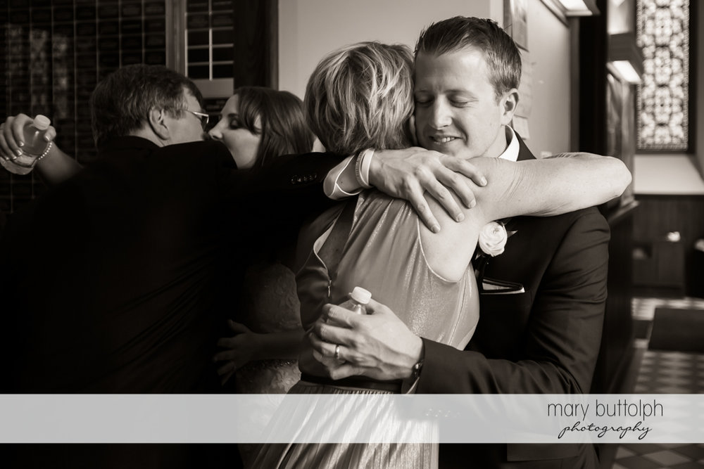 Couple embrace their parents after the wedding at Skaneateles Country Club Wedding