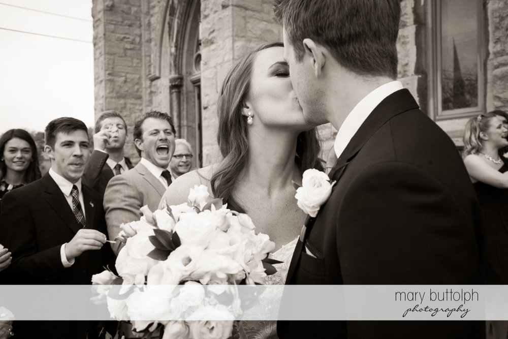 Couple kiss in front of guests at Skaneateles Country Club Wedding