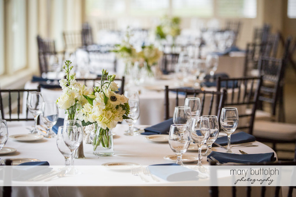 Flowers decorate the dining tables at Skaneateles Country Club Wedding