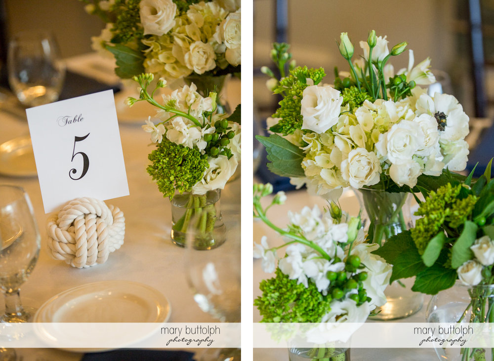 Close up shot of flowers at table 5 at Skaneateles Country Club Wedding