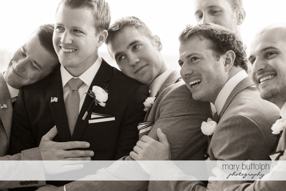Groom and his groomsmen pose for the camera at Skaneateles Country Club Wedding
