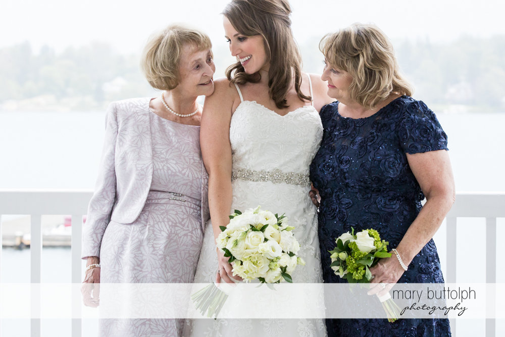 Bride shares a light moment with relatives at Skaneateles Country Club Wedding